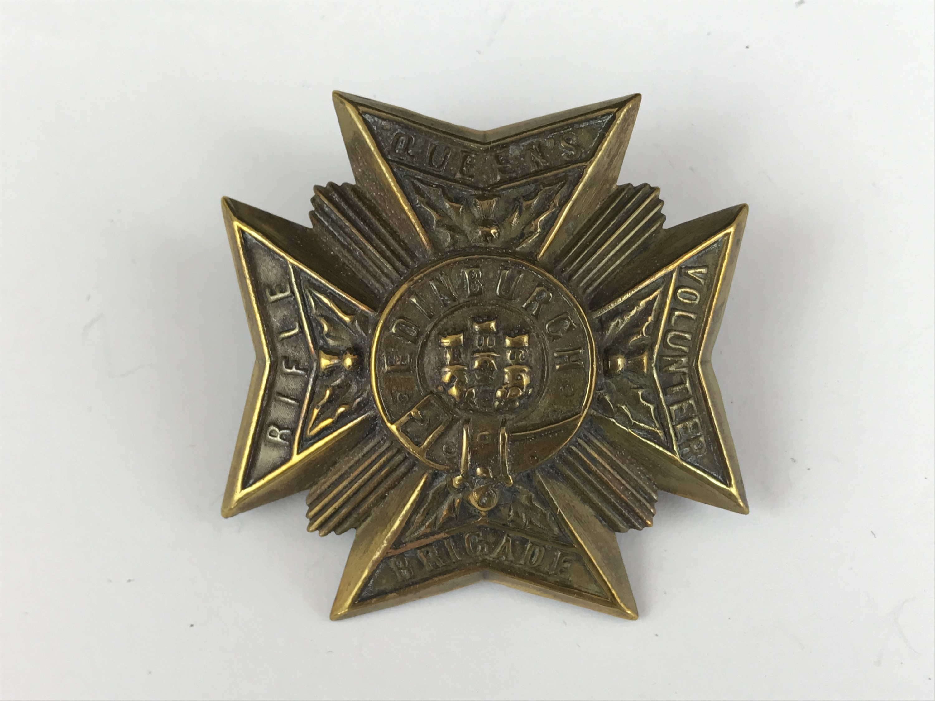 Lot 58 - A Queens Edinburgh Rifle Volunteer Brigade cap badge