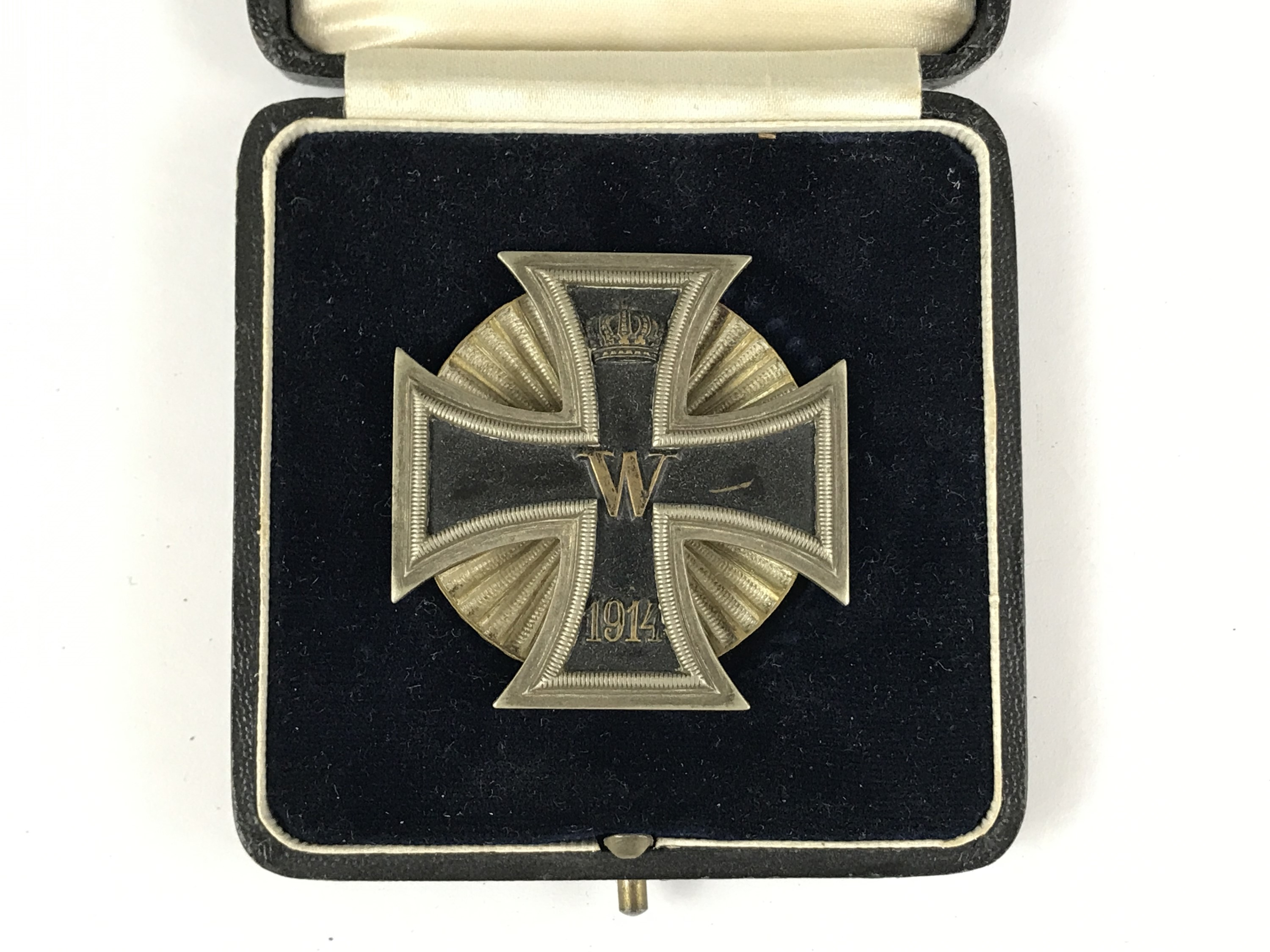 Lot 5 - A cased Imperial German 1914 Iron Cross first class, of subtly convex form and with screw-back