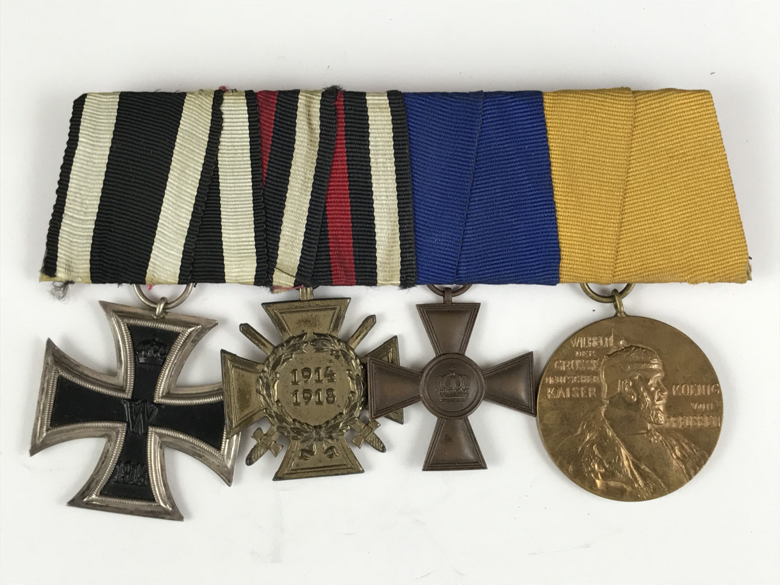 Lot 7 - A mounted group of four German Great War medals including an Iron Cross second class