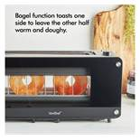(HZ23) 2 Slice Glass Window Toaster With transparent panels on each side, this sleek 2-slice t...