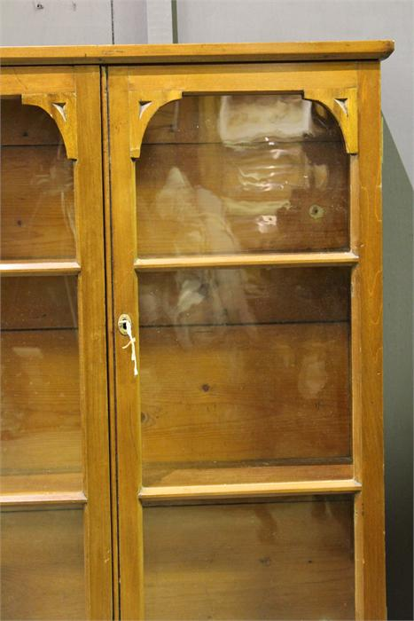 Lot 102 - A 19th Century Walnut wall mounted display cabinet with glazed doors. (Key in Office)
