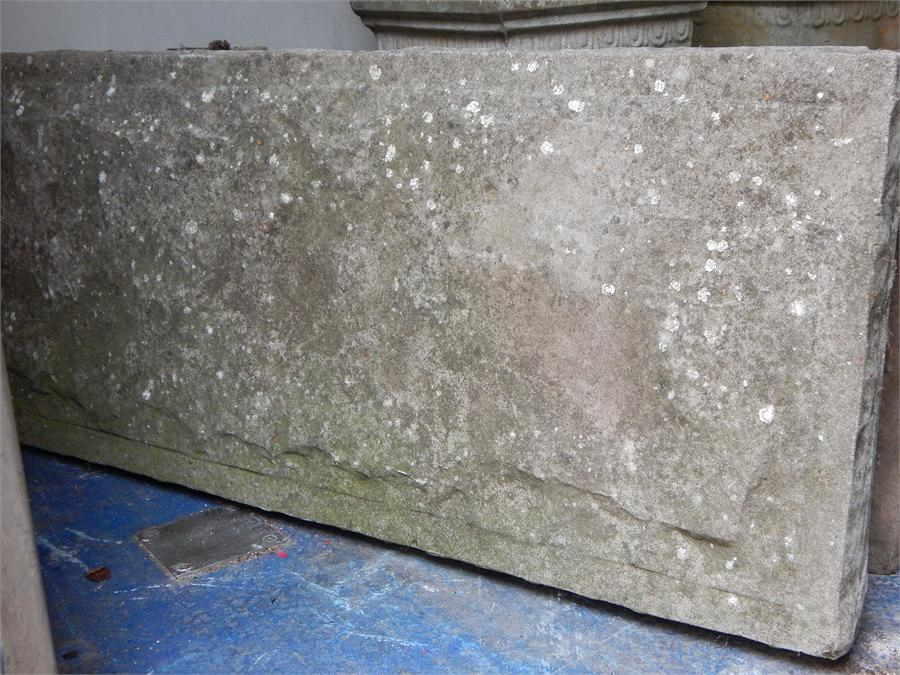 Lot 17 - a weathered concrete garden bench in three parts.