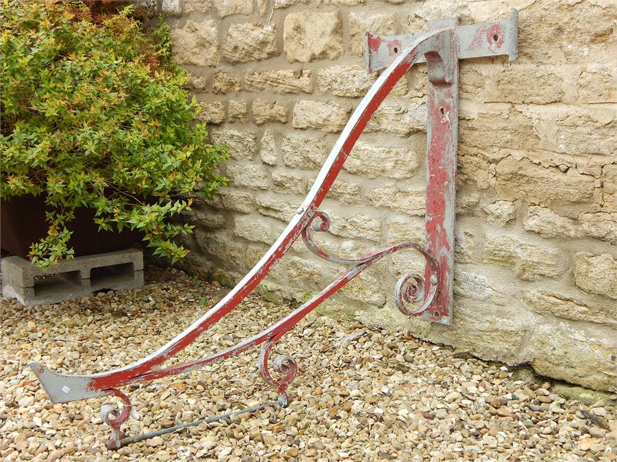 Lot 7 - Metal hanging shop sign bracket in red / grey paint - modern.