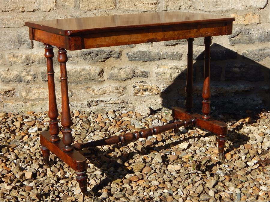 Lot 93 - Library table on castors.