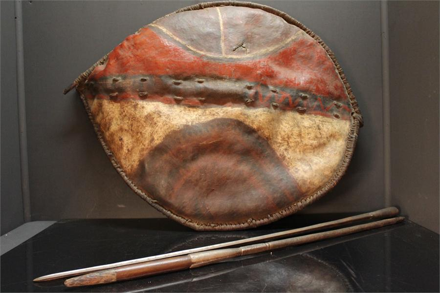 Lot 395 - An authentic ethnic Maasai warrior's Shield (87cm) and twin section spear; the shield has spear