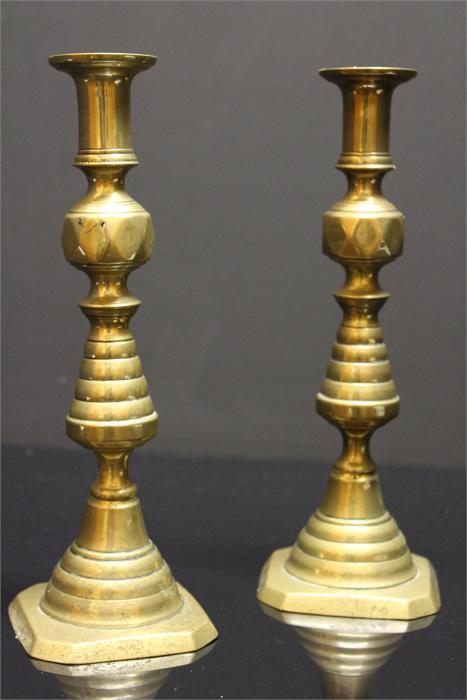 Lot 67 - A Pair of 19th century Brass Candlesticks with push-up rod ejectors