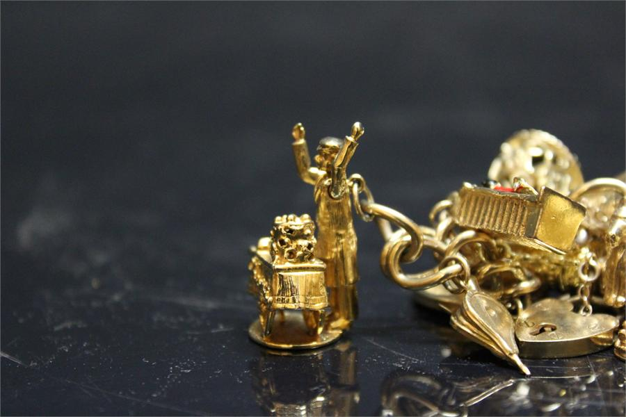 Lot 289 - Gold charm bracelet, with charms (some hallmarked) inc. 1913 half sovereign , overall weight 83.8g