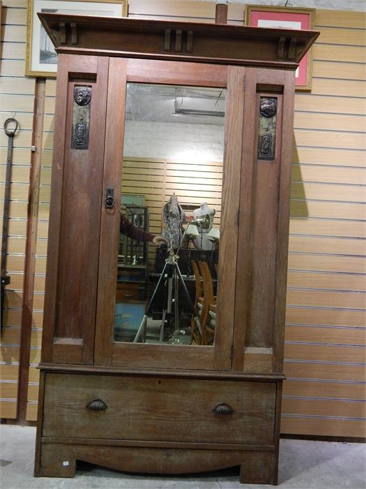 Lot 104 - Arts and crafts Oak Wardrobe, mirrored door, stylised copper / metal inset - pelmet and base