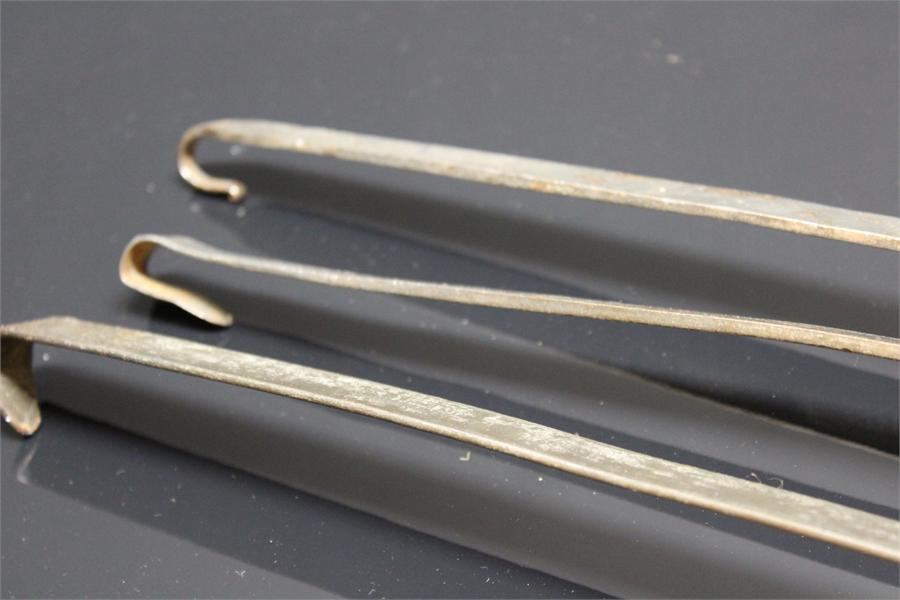 Lot 65 - Three Hanging Metal Spoons