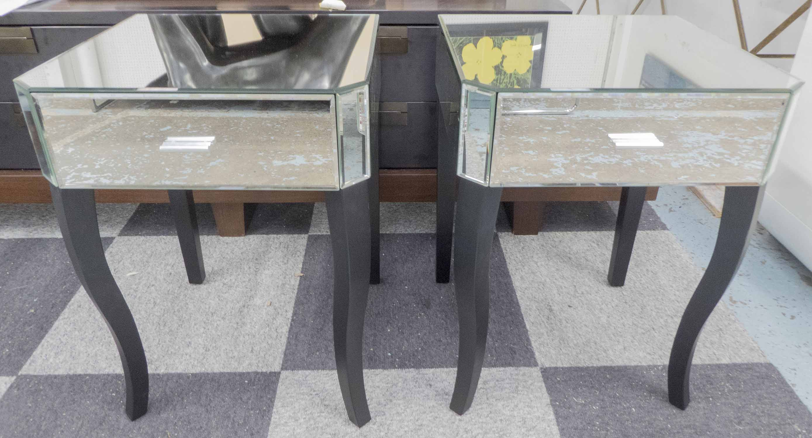 Lot 45 - MIRRORED BEDSIDE TABLES, a pair, with single drawer on ebonised cabriole legs, 46cm square x 62cm H.