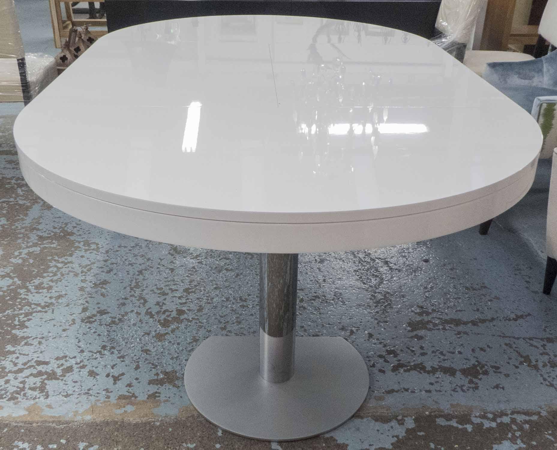 Lot 54 - LIGNE ROSET DINING TABLE, extending in white melamine finish, on metal supports,