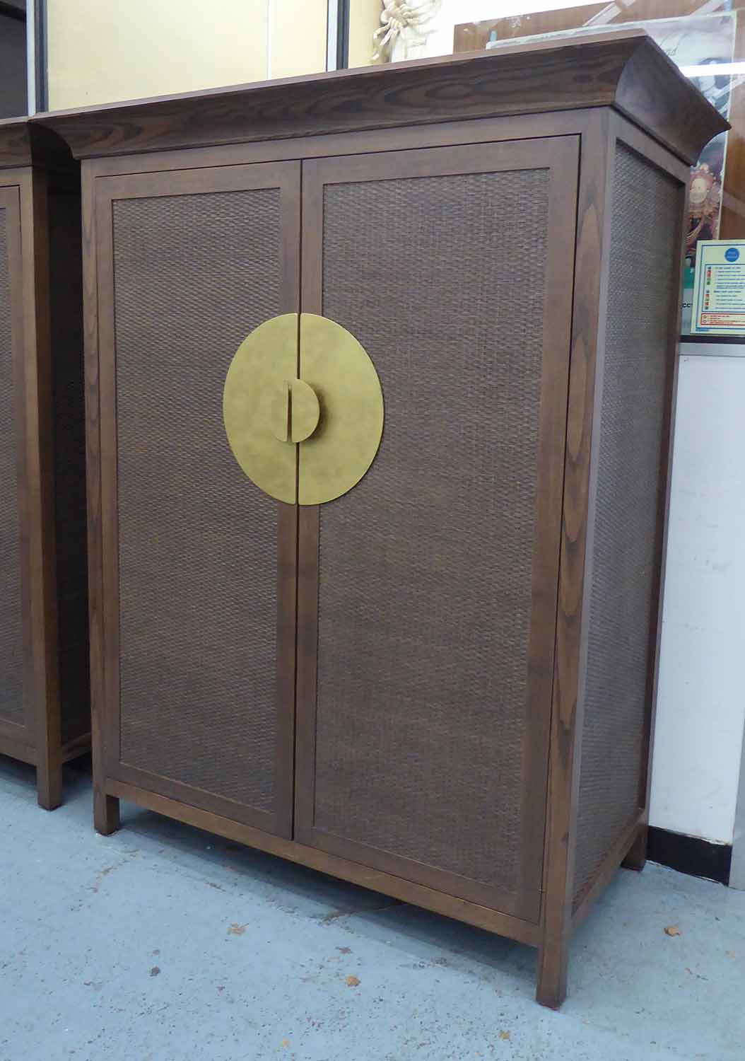 Lot 4 - MEDIA CABINET, in the oriental style, with fold away door mechanism, 136cm W x 68cm D x 170cm H.