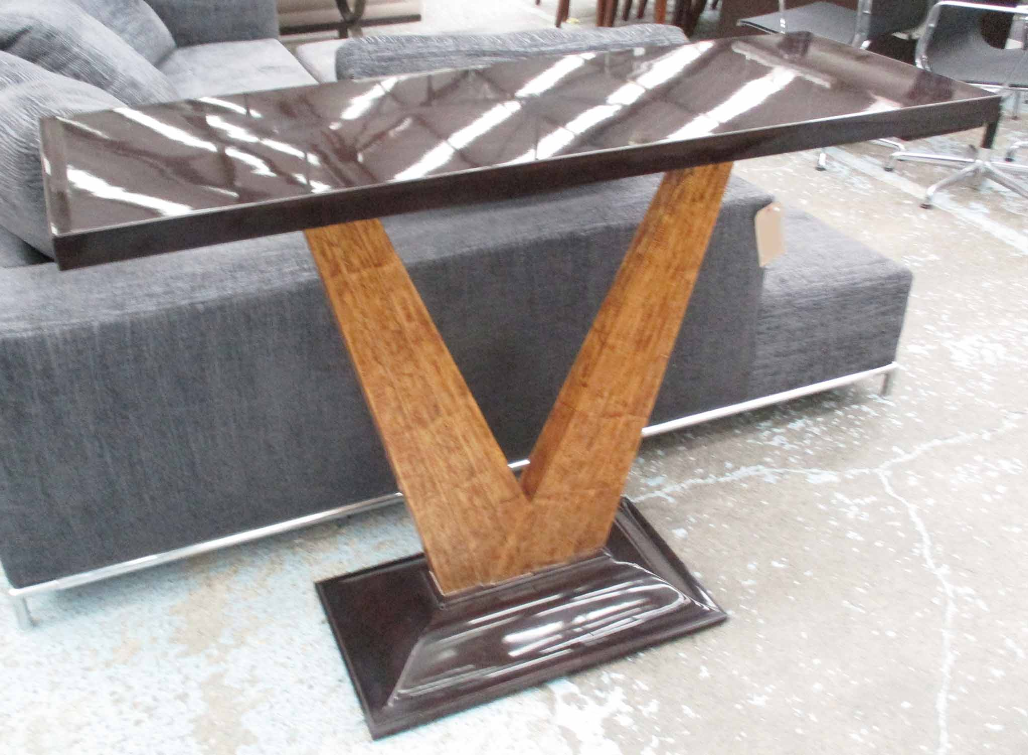 Lot 60 - CHRISTOPHER GUY CONSOLE TABLE, with black lacquered top, on wooden V shaped supports,