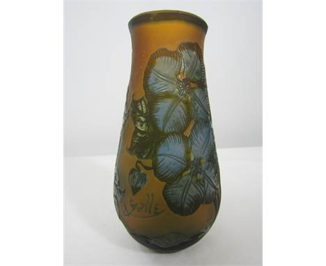 After Emile Galle - Art Nouveau cameo glass baluster vase decorated in relief with blue hibiscus flowers upon an orange groun