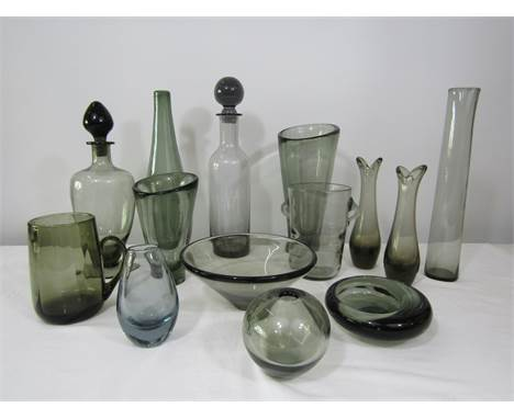 A large collection of smoked glass mainly by Holmegaard together with other makes to include a Wedgwood decanter (14)