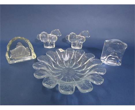A collection of Scandinavian clear glass to include a Holmegaard bowl in the form of a flower, pair of Pukeberg paperweights