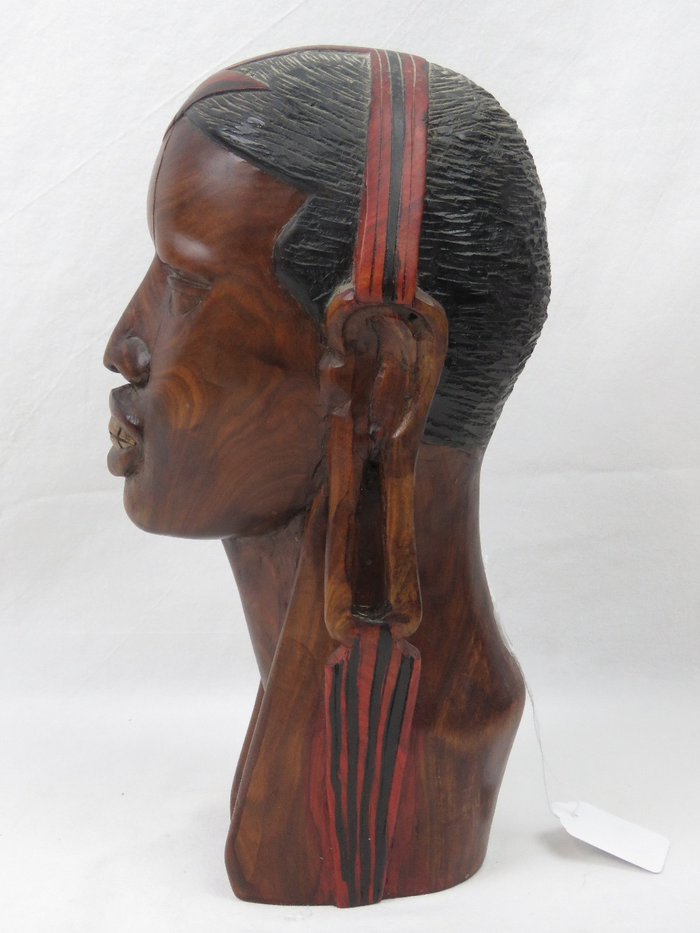 Lot 442 - A well carved wooden bust of an African