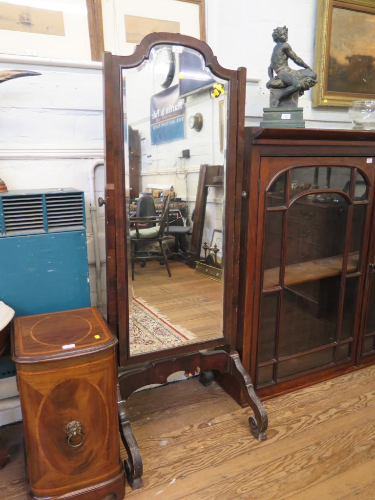 Lot 61 - A 1920s mahogany cheval mirror, the shaped bevelled plate on carved scroll feet, 167.5cm high