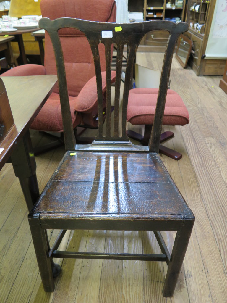 Lot 25 - An 18th century mahogany drop leaf table, on turned legs and club feet 121cm wide, and a George