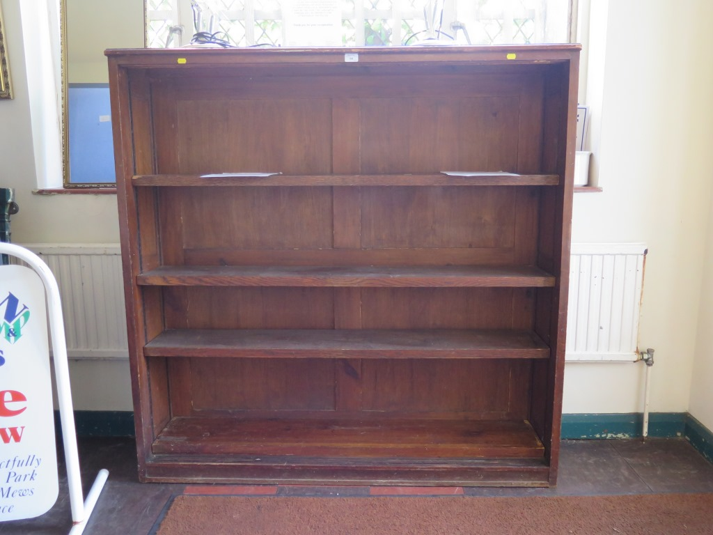 Lot 14 - An oak open bookcase with four adjustable shelves, 137cm wide, 137cm high