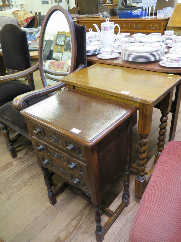 Lot 31 - A carved oak chest of three drawers on turned legs 45cm wide, a table with barleytwist legs, and