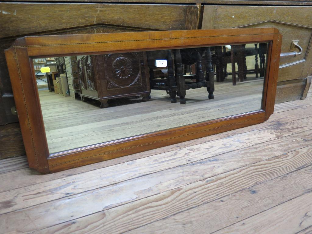Lot 17 - A mahogany framed rectangular wall mirror 103cm x 41cm