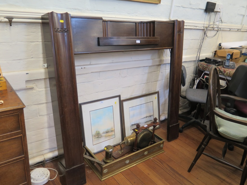Lot 26 - A 1920s mahogany mantelpiece, with inset shelf and moulded supports, 135cm wide