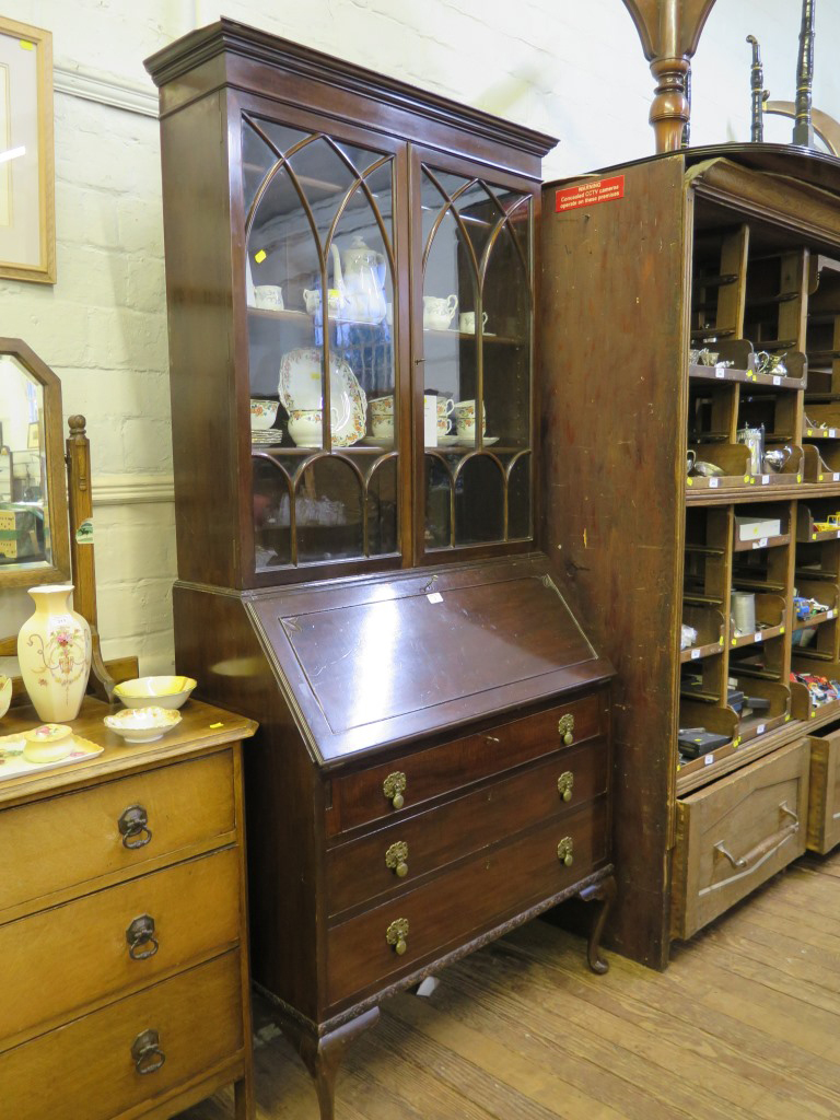 Lot 3 - A 1930s mahogany bureau bookcase, with arched glazing bars over a sloping fall enclosing pigeon