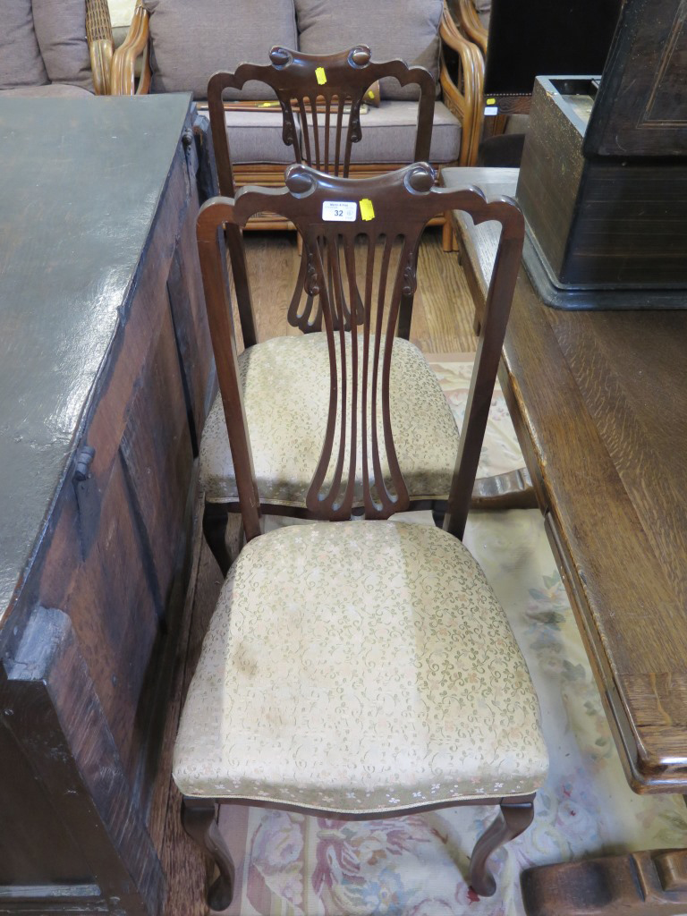 Lot 32 - A pair of Edwardian stained beech bedroom chairs, with scrolled top rails, pierced waisted splats