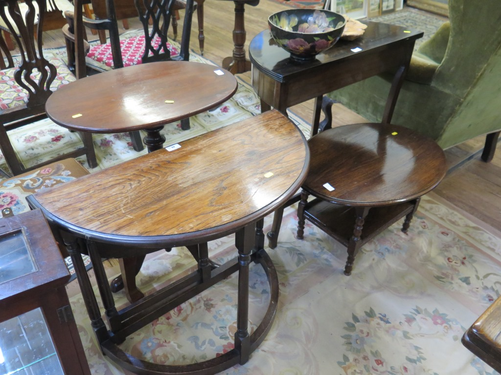 Lot 48 - Three oak occasional tables and a mahogany demi-lune side table (4)