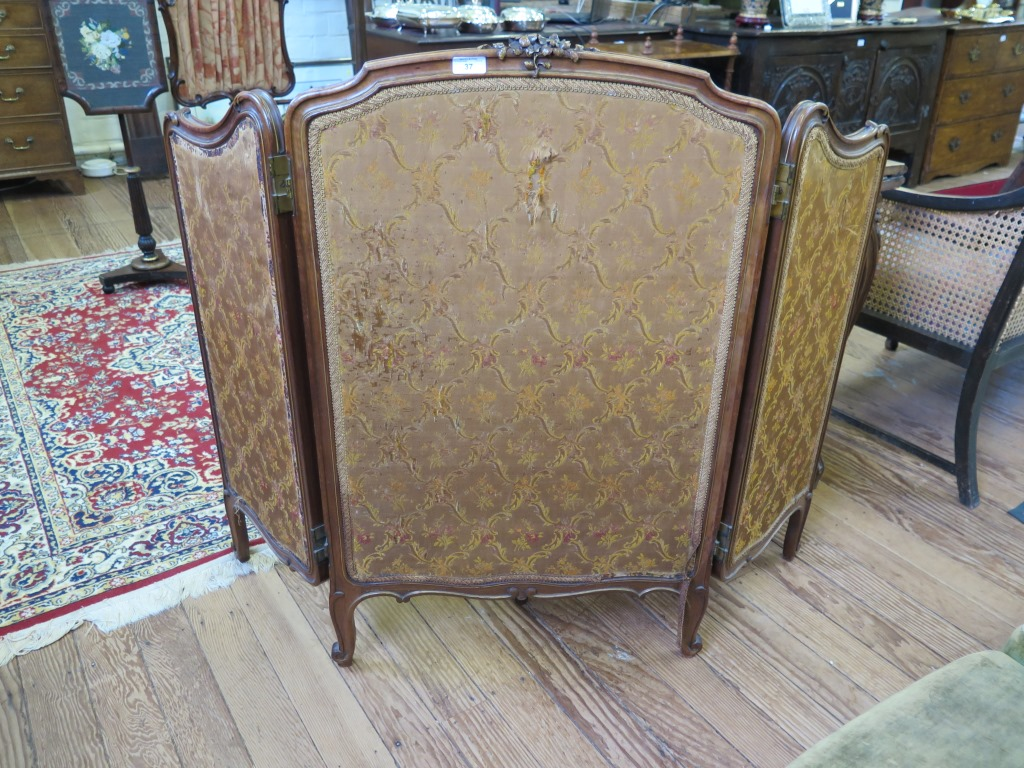 Lot 37 - A late 19th century French parcel gilt triptych fire screen, on cabriole legs, 99cm high