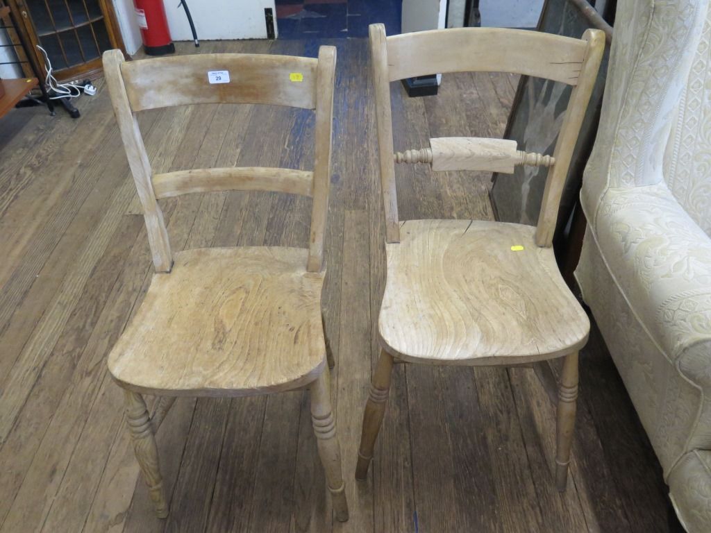 Lot 29 - Two beech and elm kitchen chairs with rail backs and turned legs (2)