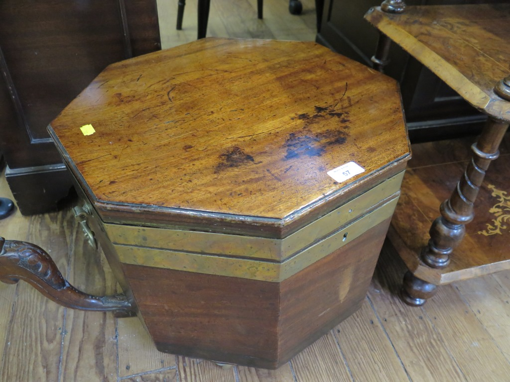 Lot 57 - A 19th century brass bound mahogany wine cooler, octagonal on later castors, lacks base, 48cm wide
