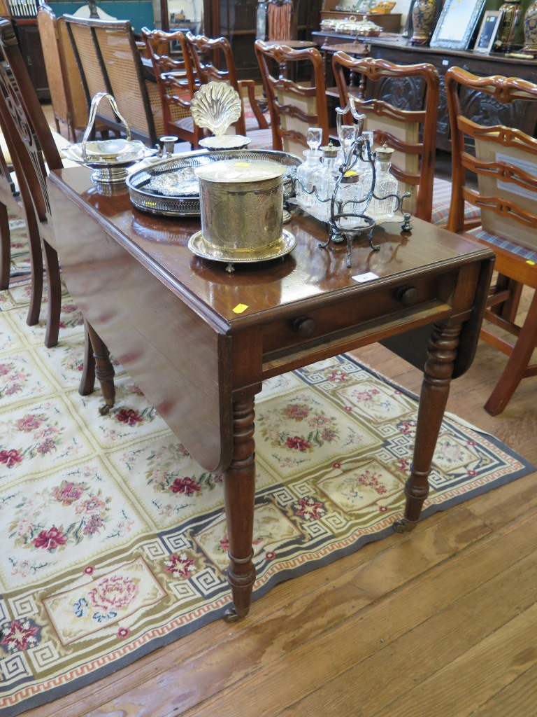Lot 47 - A Victorian mahogany Pembroke table with single end drawer on turned tapering legs with brass caps