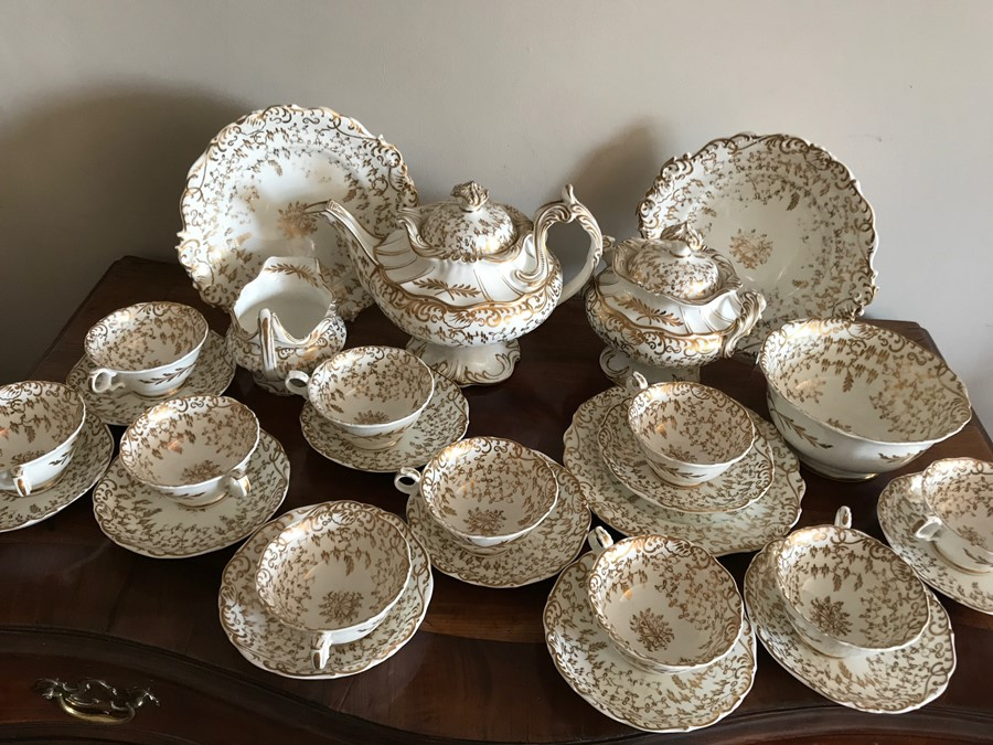 Lot 25 - White and gilt 19thC tea service, 27 pieces, small chip to teapot spout and some nibbling to gilt in