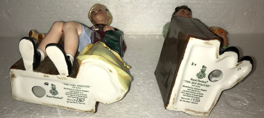 Lot 8 - A pair of Royal Doulton figures The Girl Evacuee, HN3203, No. 1727/9500 and The Boy Evacuee