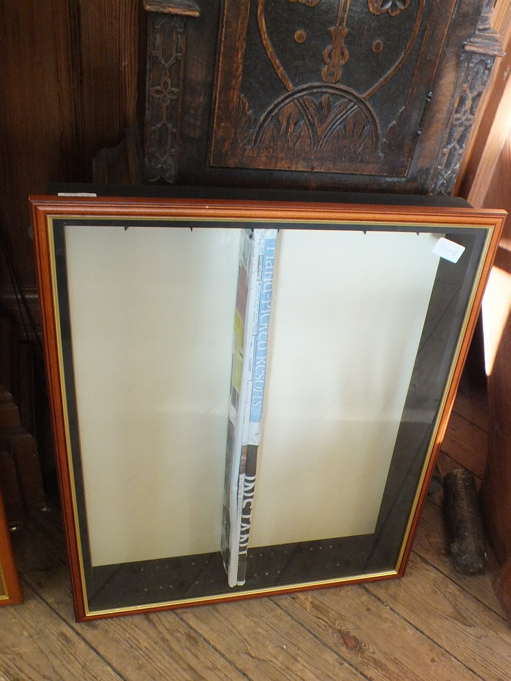 Lot 1046 - A wall hanging glazed display cabinet