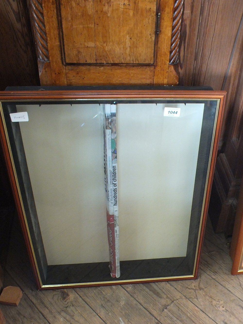 Lot 1044 - A wall hanging glazed display cabinet