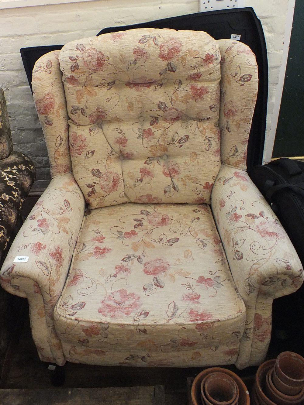 Lot 1006 - A modern floral upholstered armchair