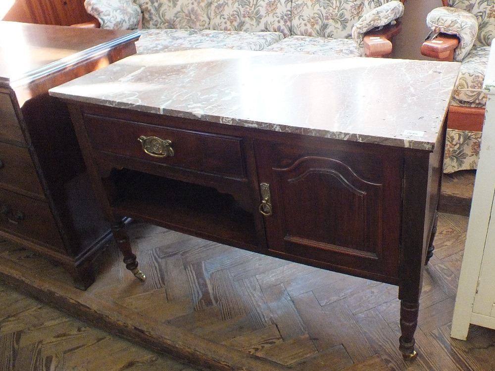 Lot 1023 - An Edwardian mahogany rouge marble top washstand with single drawer and door
