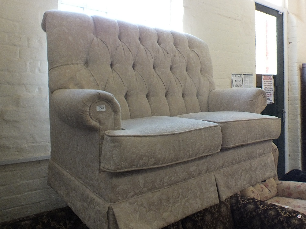 Lot 1005 - A modern beige upholstered two seater settee