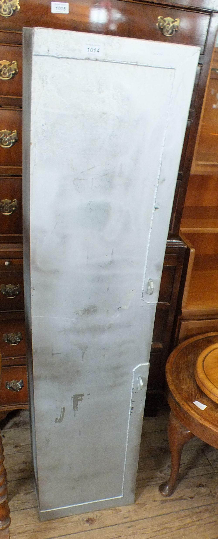 Lot 1014 - A metal storage upright cabinet