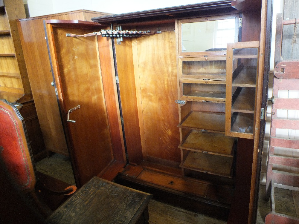 Lot 1060 - A mahogany two door compendium by Compactum of London,