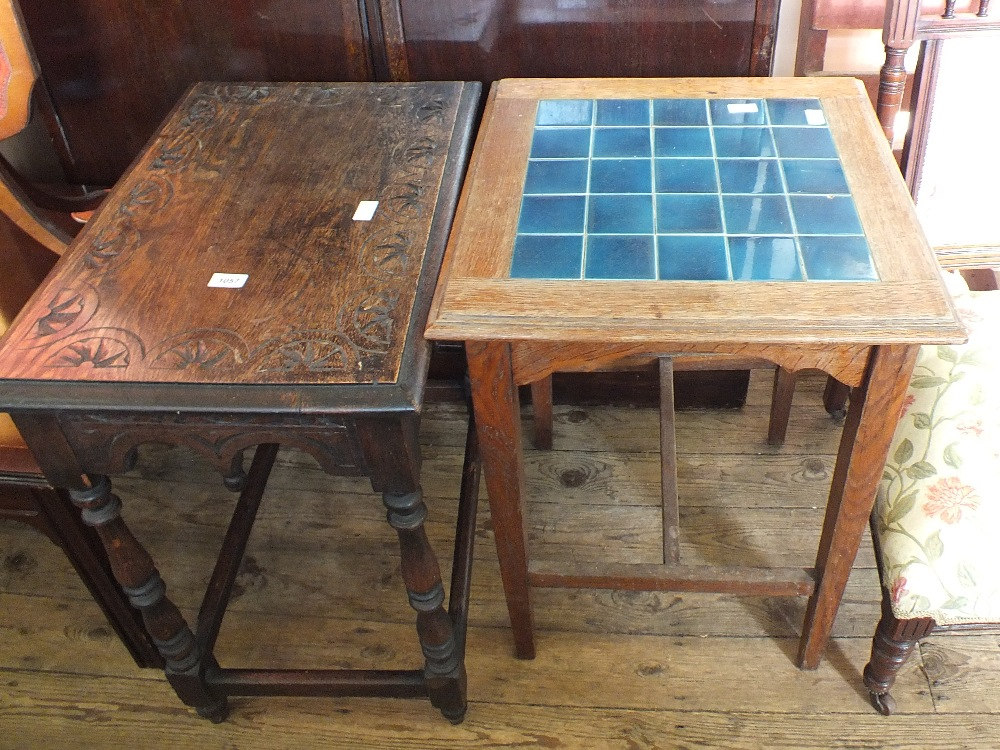 Lot 1057 - A carved oak occasional table plus one other with blue tiled top