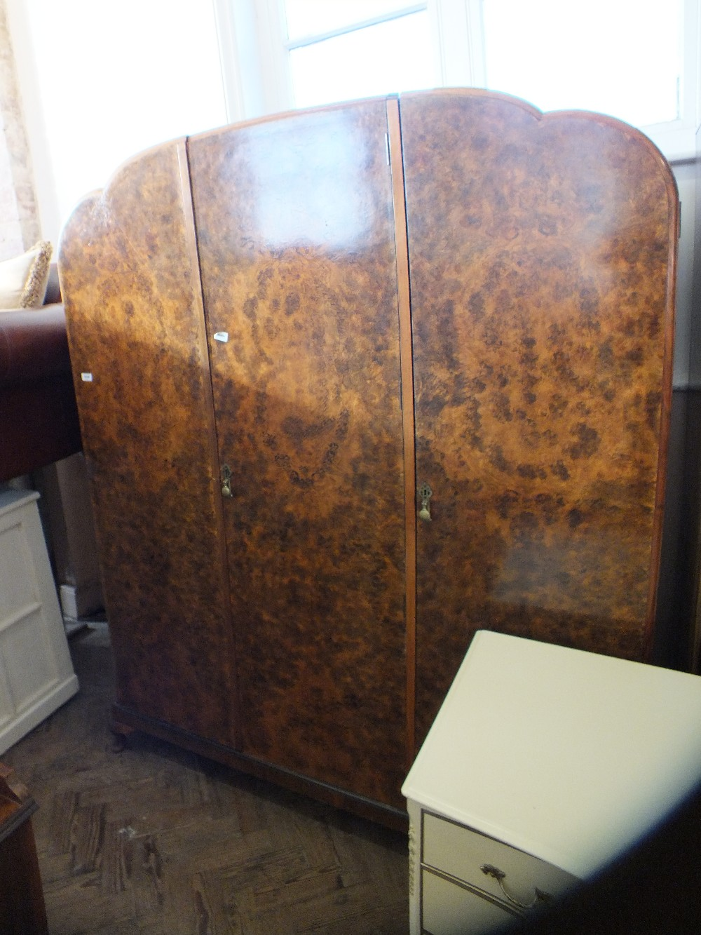 Lot 1036 - A 1930's burr walnut wardrobe and dressing table