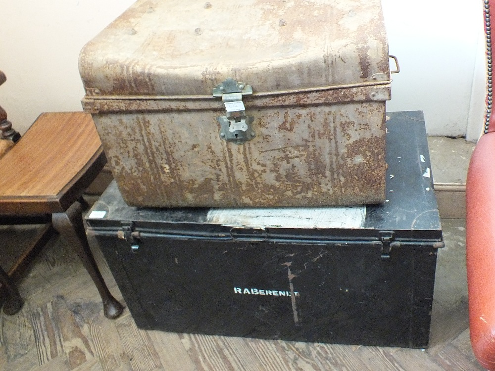 Lot 1032 - Two tin trunks and contents