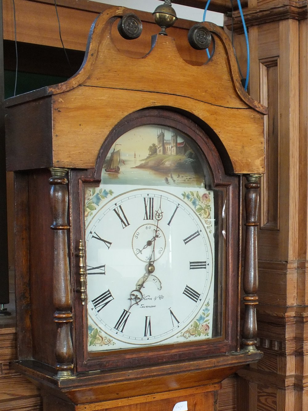 Lot 1043 - A 19th Century mahogany 30 hour long cased clock with painted arched dial by Kern & Co Swansea