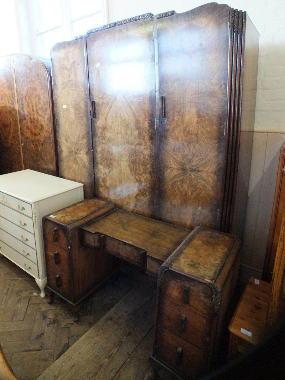 Lot 1038 - A 1930's walnut wardrobe and dressing table