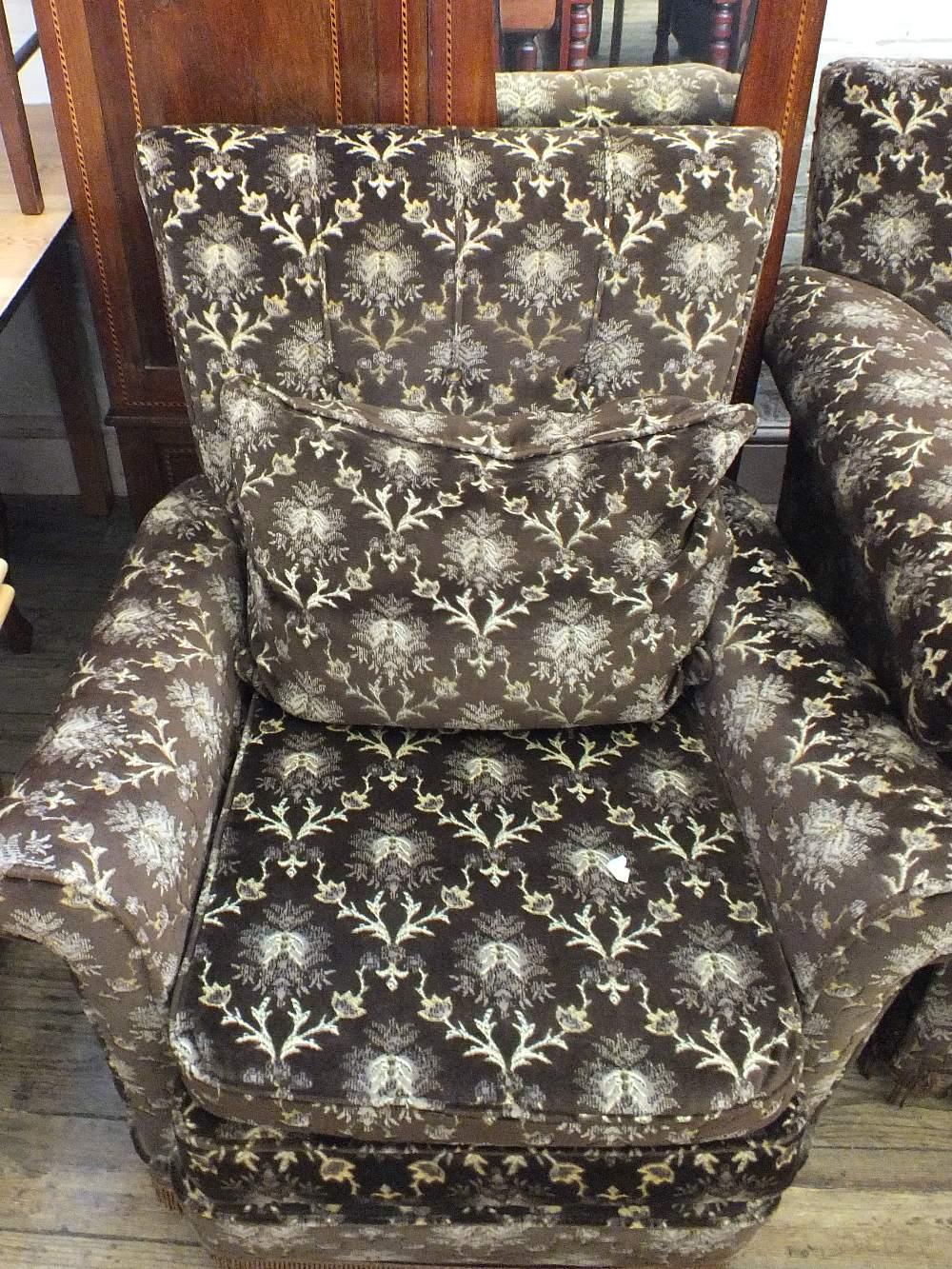 Lot 1004 - A Victorian three seater settee and armchair in brown velour