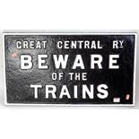 An original cast iron Great Central Railway 'Beware of the Trains' sign, repainted example, white on
